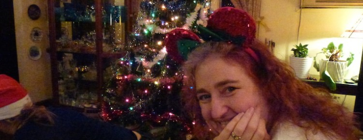 Me in front of my parents' Christmas tree